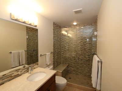 Main bathroom has a large, mosaic tile shower and double vanities