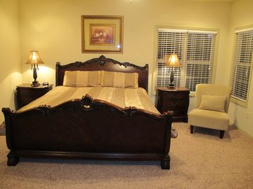 Large master bedroom with private bath, spa tub and separate shower