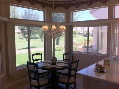 Charming in-kitchen dining table seats four and has views of the golf course