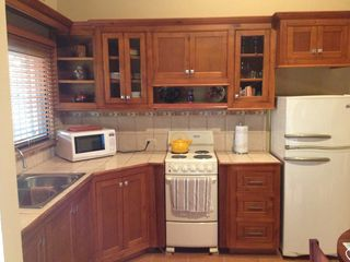 Playa del Coco condo photo - Kitchen equipped with fridge, stove, oven and microwave