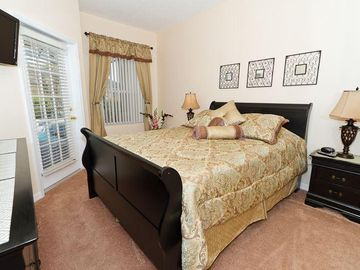 2nd Master Bedroom with queen size bed and walk out to pool
