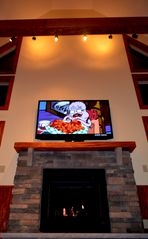 Lake Harmony chalet photo - Great Room with 65' Flat Screen, Blue Ray, Nextflix & See through Fireplace