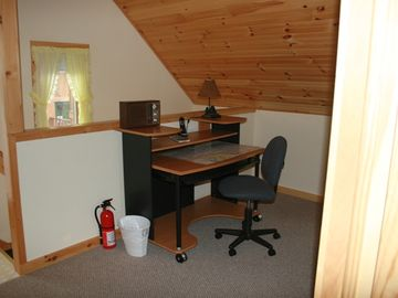Work area upstairs. Wireless internet available at no charge.