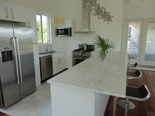 Governor's Harbour villa photo - Kitchen with Jenn Air and Bosch stainless steel appliances and marble countertop