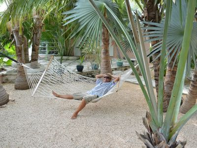Guest relaxing amongst the palm trees at Villa Tropica