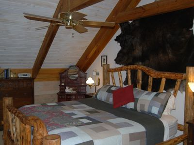 King bedroom upstairs with Idaho log Headboard and family Buffalo hide