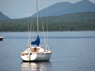Rockwood cabin photo - Sailboat moored on a buoy on Moosehead Lake in Rockwood.