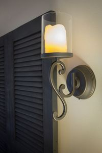 Flameless candle sconces flank the headboard. Just flip the switch.