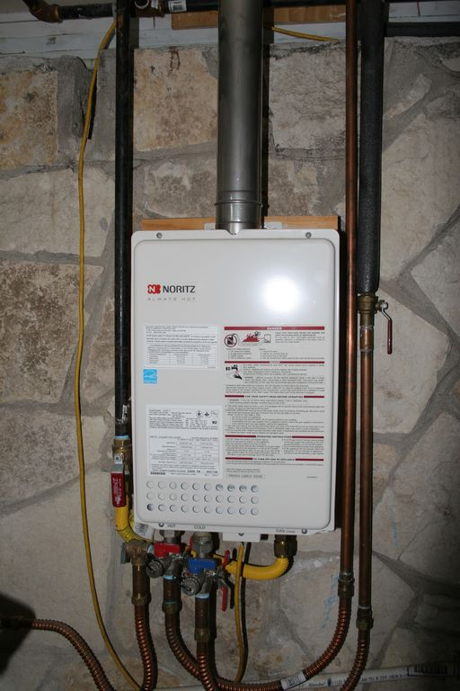 This tankless water heater is just for the apartment. Fills the tub in a jiffy!