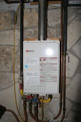 Austin studio photo - This tankless water heater is just for the apartment. Fills the tub in a jiffy!