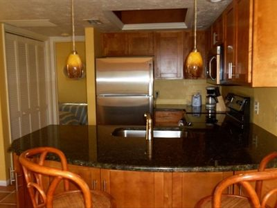 Upgraded granite kitchen with stainless steel appliances.