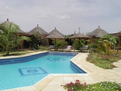 African hut comfort on estate with pool