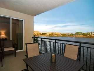 Cocoa Beach condo photo - Relax on the covered balcony and watch the dolphins & manatees swim by!