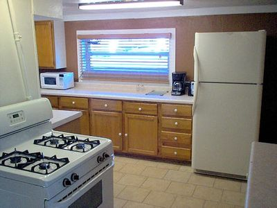 L-shaped kitchen with lots of cabinets