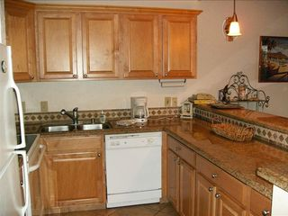 Remodeled fully equipped kitchen, all utensils for cooking and bar-b-que - Lahaina condo vacation rental photo