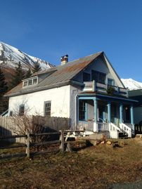 Seward house rental - Side view, mountains in the background. Brand new roof going on in April!