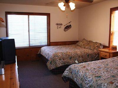 Richfield cabin rental - Downstairs bedroom with 2 queen beds and a view of the lake