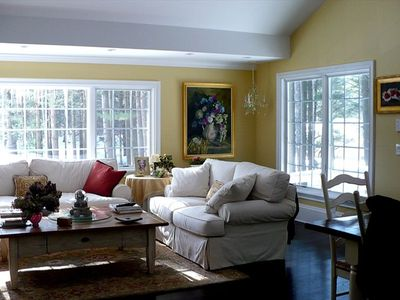 Vaulted ceiling living room with large windows