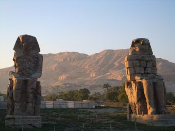 The Collossi of Memnon with Valley of Kings beyond