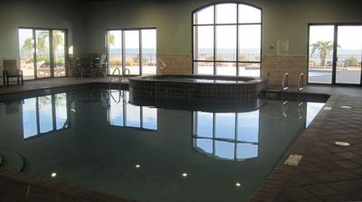 Large ocean front indoor pool and spa overlooking the Center pool and beach