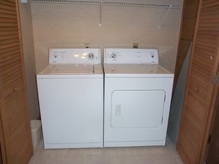 Washer, dryer, ironing board & iron - Pigeon Forge cabin vacation rental photo