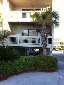 Townhouse has carport parking and two balconies.