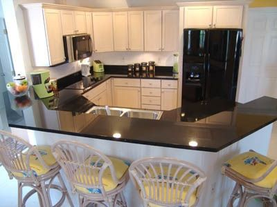Granite Kitchen with High-tech built-in appliances.Lime green small appliances