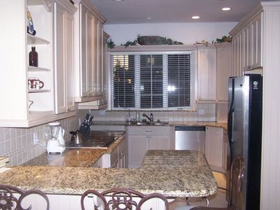 Large Gourmet kitchen with breakfast bar, plus dining table and chairs