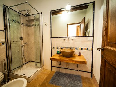 Lower adjoining suite bathroom one