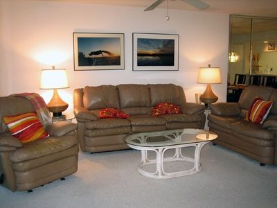 Living room with reclining chair.  Sofa also recline.