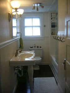 Upstairs bath with tub & shower -- vintage shelves and closet