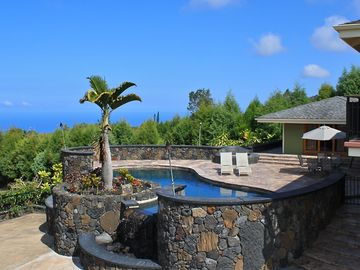 Captain Cook house rental - Enjoy panoramic views of the ocean & tropical landscape from the patio.
