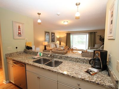 Beautiful granite countertops and kitchen bar seating for two