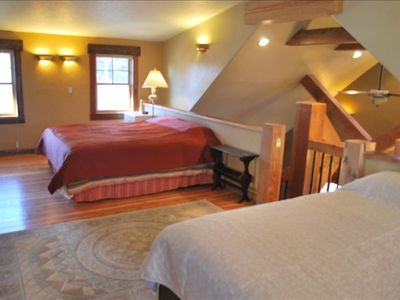 Upstairs bedroom includes a king bed and a queen bed.