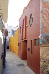 Enter your 2006 contemporary Mexican house from the callejon - a walking street.