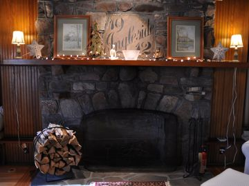 Wood burning fireplace in living room.