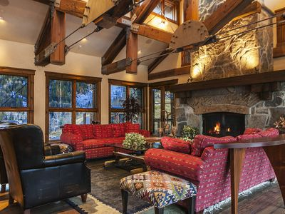 Great room with massive stone fireplace and ceiling detail