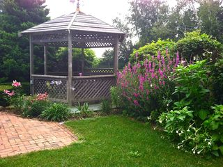 Water Mill house photo - Gazebo with beautiful flowers