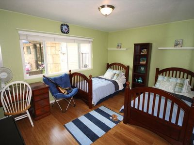 Bedroom #1. Two beds + inflatable queen bed avail, flat screen TV, games, more.