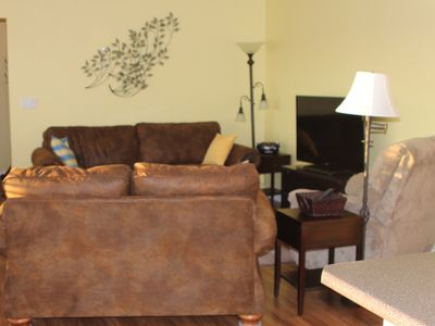 Living room area with a sofa sleeper, love seat and recliner for your comfort