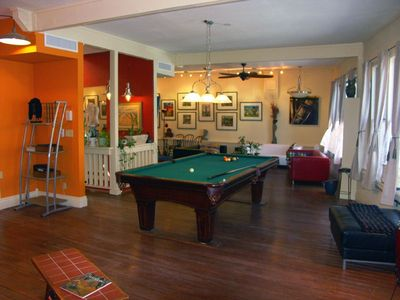 The living room of the Bisbee Loft, with pool table. Facing the seating area.