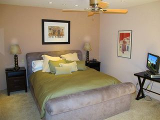 Indian Wells house photo - Master bedroom with king bed, en suite bathroom, flat screen t.v. and DVD player