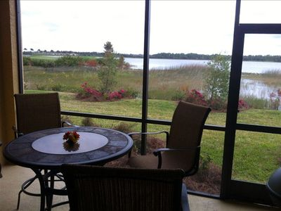Back Lanai has fan, light, and grill available with view of lake and Oak # 20.