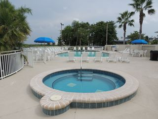 Ruskin townhome photo - Enjoy one of the two hot tubs & swimming pool facing the Tampa Bay
