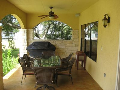 Outside dining room and gas grill