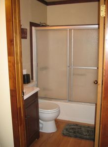 The upstairs bathroom has a full bath and shower