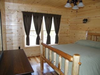 Luray cabin photo - Guest bedroom with log bed and nature light