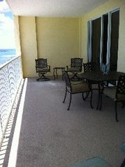 Ocean Reef property rental photo - huge balcony.table for 4, a bistro set, and 2 very comfortable chaise lounges