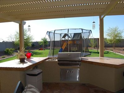 Outdoor gas BBQ island. Trampoline no longer at home. Outdoor misting system