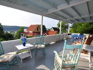 Peaks Island cottage photo - Porch looking over to Diamond Passage, Amazing Sunsets and Boat Traffic.